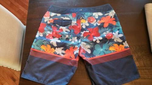 Men's board shorts, Hawaiian tags.